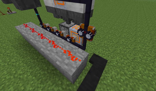 A servo finishing its round sends a Redstone pulse to tell the rest to move forward in the queue.