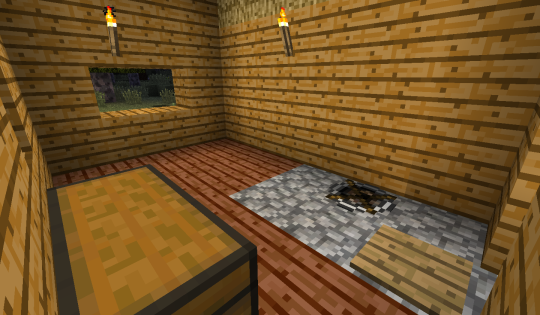 The inside of my humble cabin. I don't know if the cobblestone around the firepit is actually necessary, but it looks cool.