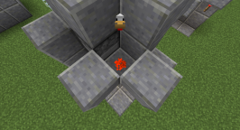 This image shows the piece of redstone dust that sits on top of the block that the second redstone torch is attached to. The redstone sits right behind a second dispenser that sits on top of the egg dispenser.