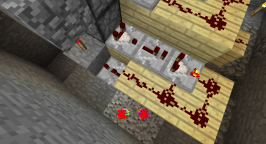 This is a modification of a comparator clock that I have used in the past. Specifically, I am using repeaters to slow down the pulse of the clock. This powers a vertical series of redstone torches, causing items to move up the dropper chain. The red poofs at the bottom of the screen are the exhaust from my jetpack.