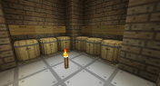 Inside I have six barrels to store grains. I get access to these grains via inventory panels from Ender IO.