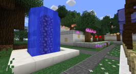 Another view of the terraced tree garden with a simple fountain in the foreground. The base of the fountain is nether quartz. The interior is celestial crystal from Biomes O' Plenty.
