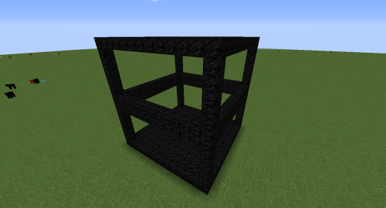 "This frame will contain both the room and its ""mirror"" version below. This frame is made from coal blocks. It is 13x13x14. The height needs to be an even number."