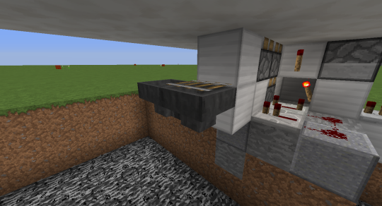 Here's what it looks like under the secret door platform. The quartz block above this rail is two blocks in front of the stairs.