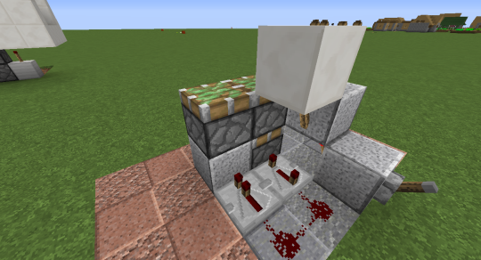 Place three sticky pistons like this, all facing up.