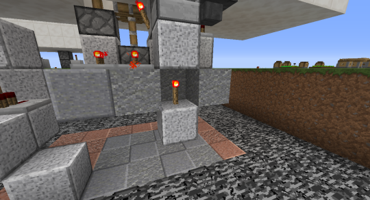 """We add a redstone torch under the input block to change this from default """"off"""" to default """"on""""."""