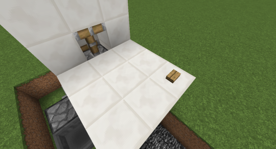 Inside the room, place a button three blocks inside and one block to the side (away from the initial input block of the redstone mechanism below).