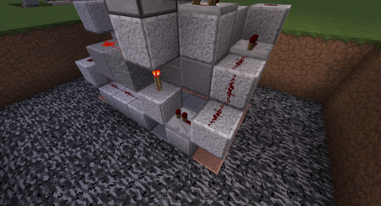 Place blocks, redstone dust, and one more repeater like this to connect the second button to the piston mechanism.