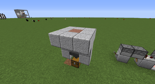 The polished granite block sits directly above the hopper cart. Now, any item tossed onto the granite block will disappear and makes its way into the chest below.