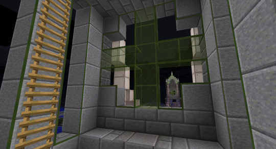 The middle room of the end tower. I used Green Stained Glass and Green Enlightened Clear Glass (from Ender IO) on my windows.
