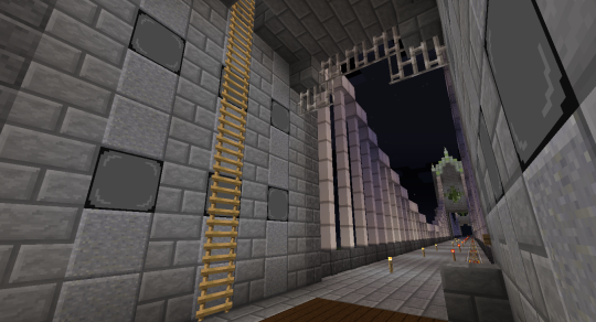 The main floor of the end towers. Those are Black Diamond Lamps on the wall (from Silent's Gems). Hanging from the ceiling are Tin Fence Pieces (from Base Metals).