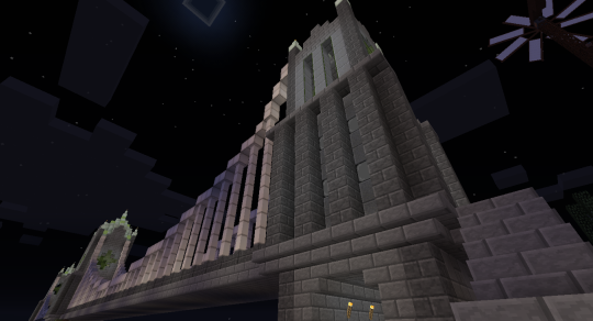 Looking up at one of the end towers. My main construction materials were actually rather limited: Stone Brick (including stairs and slabs), Polished Andesite, Dark Oak Planks, and Hardened Stone Brick (from Enironmental Tech) make up the biggest part of of my materials. Varying these materials is what gives the towers their visual interest.