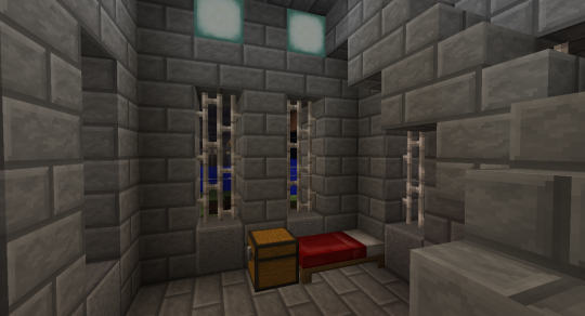 The lower room of the middle tower is a small barracks. I used Tin Fence Pieces for the windows and Seal Lanterns for lighting.