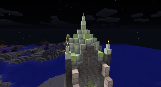 The central tower is wider, so the pyramid cap is a little more detailed. Also notice the peaks on the stone walls on each side.