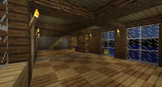 I really like the interior of the first floor, with its exposed wooden beams and checkered floor design.