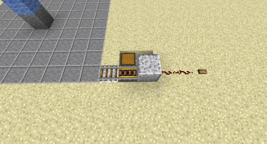 First we need a place for the Hopper Cart to rest. When not in use, it sits on an unpowered piece of Powered Rail that itself sits on a Hopper. That Hopper will pull items that the Hopper Cart gathers and send them into a chest or item sorting system.