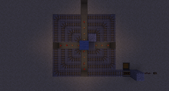 From above, it looks like this with the redstone torches placed and the Powered Rails and supporting blocks removed.
