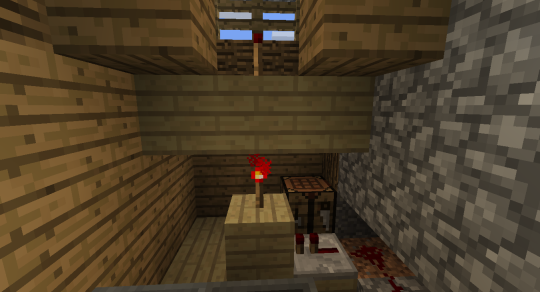 The harvesting system starts here. The second redstone signal is sent upward.